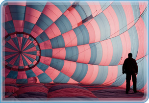 photo of man inside hot air balloon